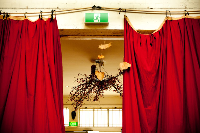 Red Velvet Curtains Autumn Leaves Exit Sign